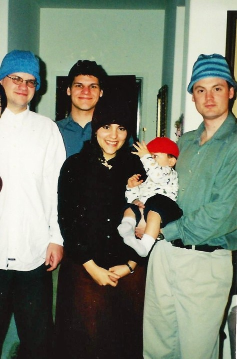 2 brothers, 1 wife well, before they were married), 1 son, 1 husband all in hats